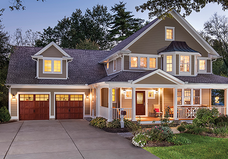 house with arbor grove entry doors and garage doors